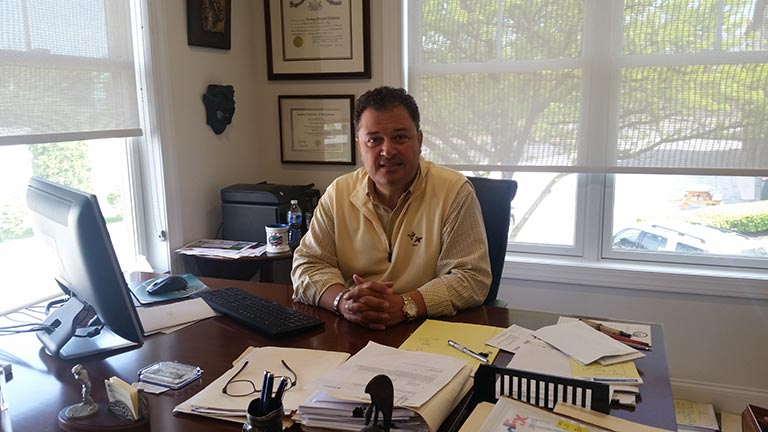 portrait of George M. Nikolaou in his office